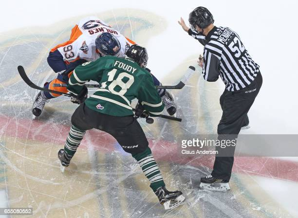Hunter Holmes of the Flint Firebirds takes a faceoff against Liam Foudy of the London Knights during an OHL game at Budweiser Gardens on March 17...