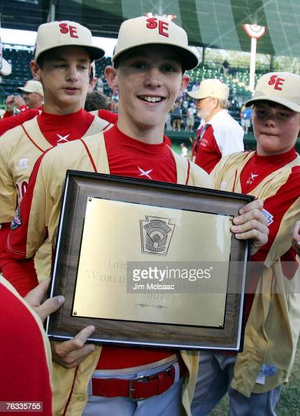 Hunter Jackson of the Southeast team from Warner Robins Georgia poses with the championship plaque after defeating the Japanese team from Tokyo Japan...