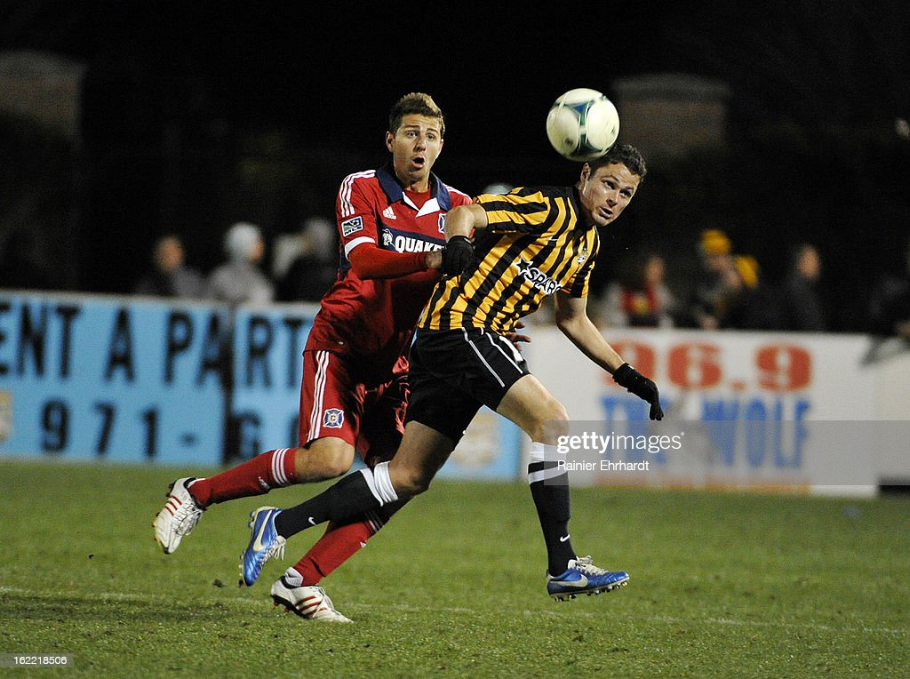 Hunter Jumper #3 of the Chicago Fire and Gibson Bardsley #14 of the Charleston Battery battle of the ball during the second half of a game at Blackbaud Stadium on February 20, 2013 in Charleston, North Carolina.