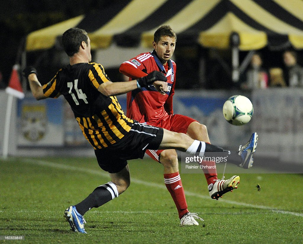 Hunter Jumper #3 of the Chicago Fire makes a pass as Gibson Bardsley #14 of the Charleston Battery defends during the second half of a game at Blackbaud Stadium on February 20, 2013 in Charleston, South Carolina.