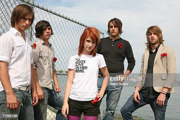 Hunter Lamb Josh Farro Haley Williams Jeremy Davis and Zac Farrro of Paramore pose for photos during the Vans Warped Tour at Bicentennial Park on...