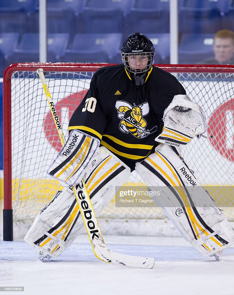 Hunter Leisner #30 of the American International College Yellow Jackets warms-up before NCAA hockey action against the Massachusetts Lowell River Hawks at the Tsongas Center on December 3, 2013 in Lowell, Massachusetts.