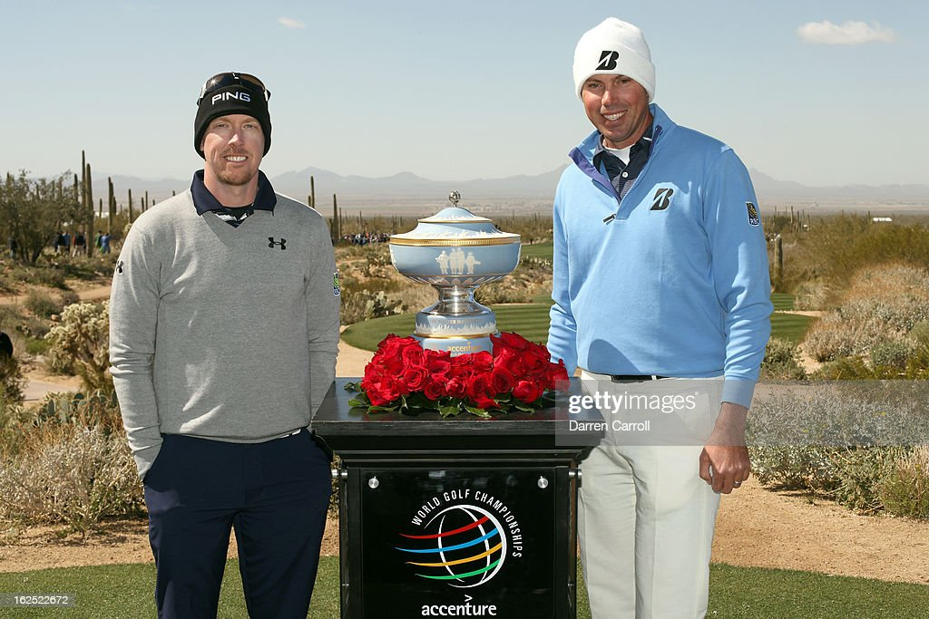 Hunter Mahan and Matt Kuchar pose for a photo with the winner's trophy prior to their championship match during the final round of the World Golf Championships - Accenture Match Play at the Golf Club at Dove Mountain on February 24, 2013 in Marana, Arizona.
