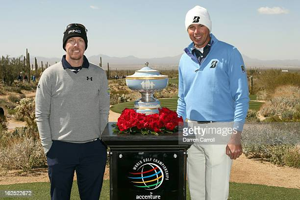 Hunter Mahan and Matt Kuchar pose for a photo with the winner's trophy prior to their championship match during the final round of the World Golf...