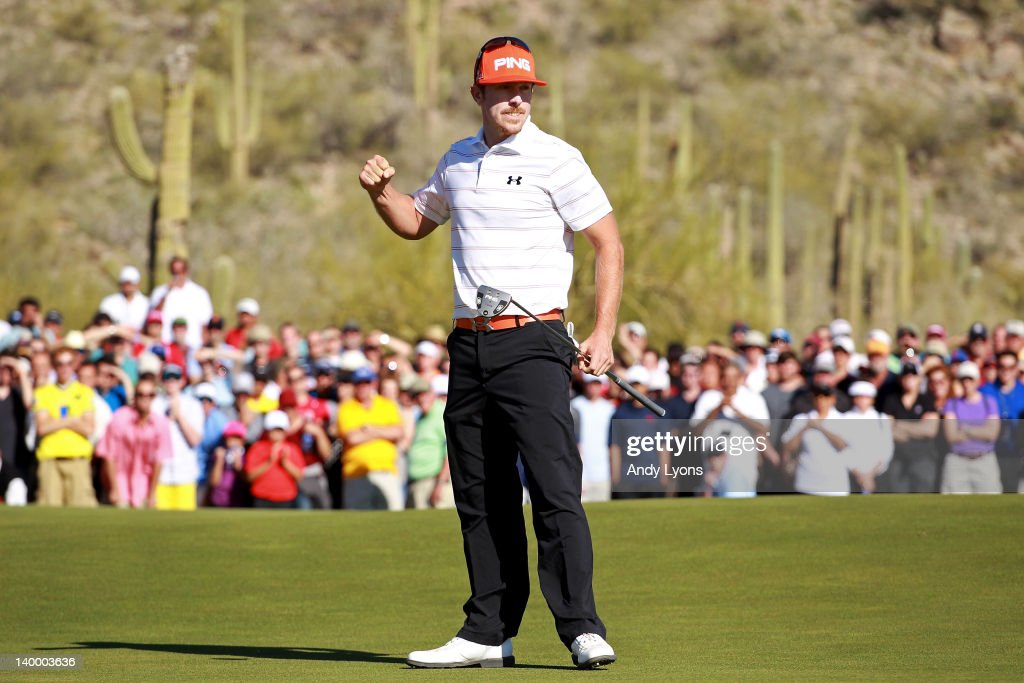 Hunter Mahan celebrates winning the championship match against Rory McIlroy of Northern Ireland 2 and 1 on the 17th hole during the final round of...