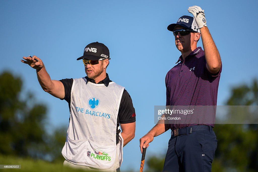 Hunter Mahan checks yardage with his caddie John Wood on the 11th hole tee box during the first round of The Barclays at Plainfield Country Club on August 27, 2015 in Edison, New Jersey.