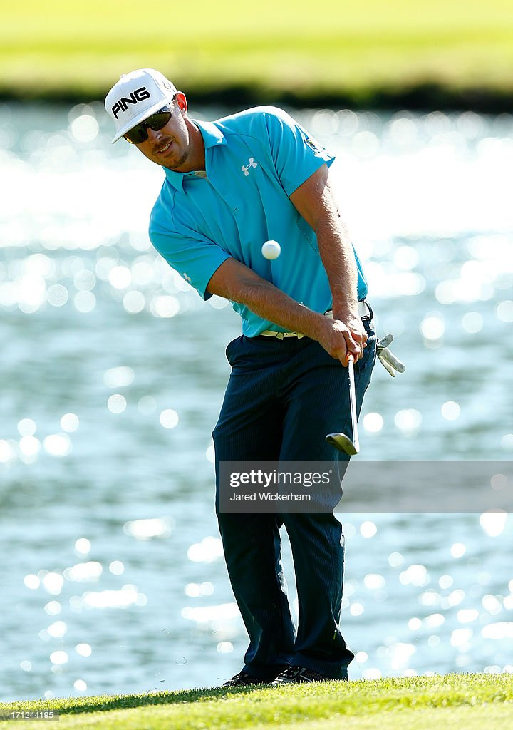 <a gi-track='captionPersonalityLinkClicked' href=/galleries/search?phrase=Hunter+Mahan&family=editorial&specificpeople=885292 ng-click='$event.stopPropagation()'>Hunter Mahan</a> chips in a shot on the 17th green during the final round of the 2013 Travelers Championship at TPC River Highlands on June 23, 2012 in Cromwell, Connecticut.