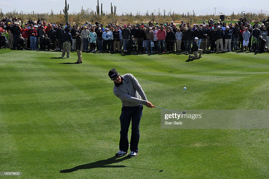 Hunter Mahan chips onto the fourth green during the final round of the World Golf Championships-Accenture Match Play Championship at The Golf Club at Dove Mountain on February 24, 2013 in Marana, Arizona.