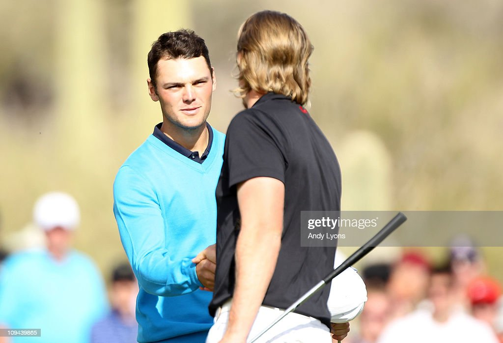 Hunter Mahan congratulates Martin Kaymer of Germany on his victory on the 17th hole during the third round of the Accenture Match Play Championship...