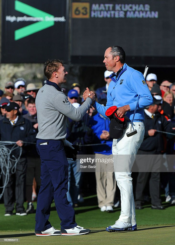 Hunter Martin congratulates Matt Kuchar after Kuchar won their championship match 2 and 1 in 17 holes during the final round of the World Golf Championships - Accenture Match Play at the Golf Club at Dove Mountain on February 24, 2013 in Marana, Arizona.