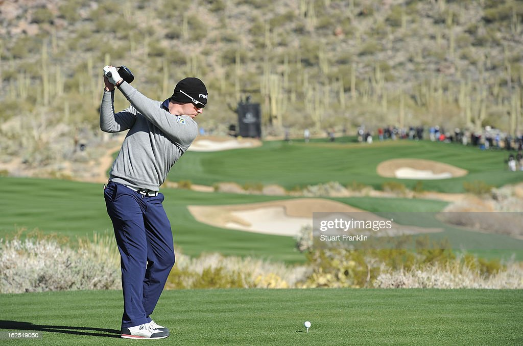 Hunter Mahan hit his tee shot on the 15th hole during the final round of the World Golf Championships - Accenture Match Play at the Golf Club at Dove Mountain on February 24, 2013 in Marana, Arizona.