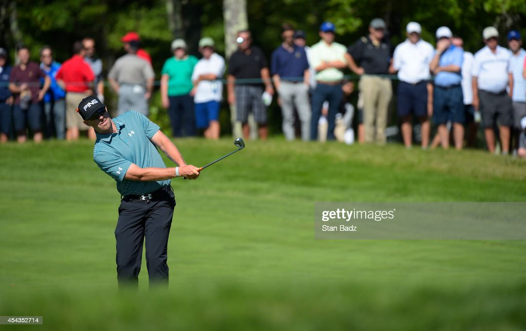 <a gi-track='captionPersonalityLinkClicked' href=/galleries/search?phrase=Hunter+Mahan&family=editorial&specificpeople=885292 ng-click='$event.stopPropagation()'>Hunter Mahan</a> hits a chip shot on the 12th hole during the first round of the Deutsche Bank Championship at TPC Boston on August 29, 2014 in Norton, Massachusetts.
