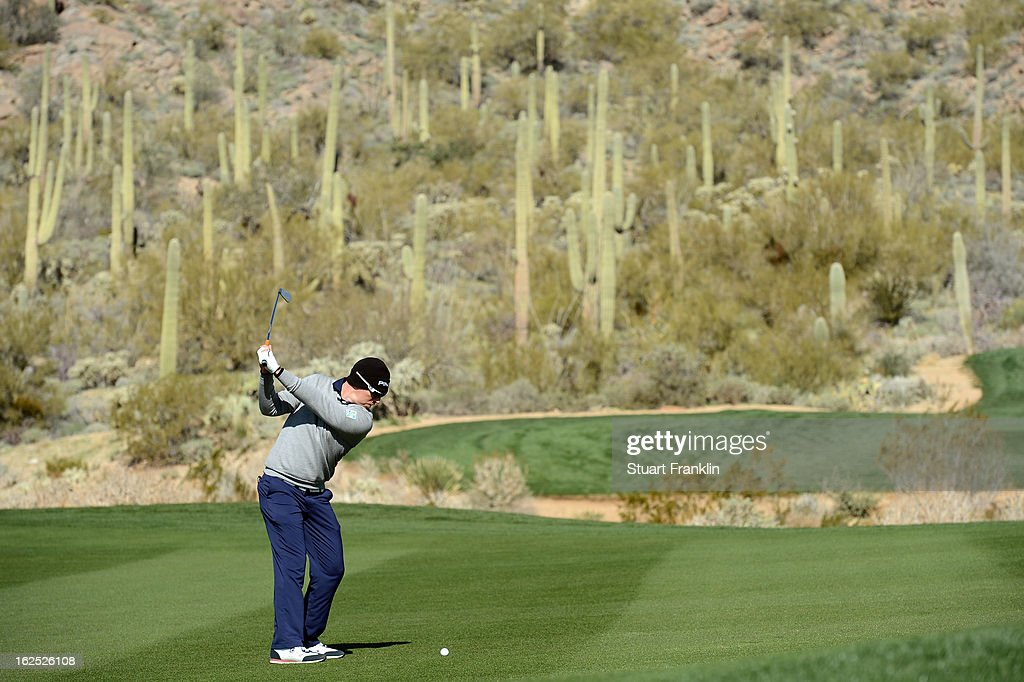 Hunter Mahan hits a shot from the fairway on the 15th hole during the semifinal round of the World Golf Championships - Accenture Match Play at the Golf Club at Dove Mountain on February 24, 2013 in Marana, Arizona.