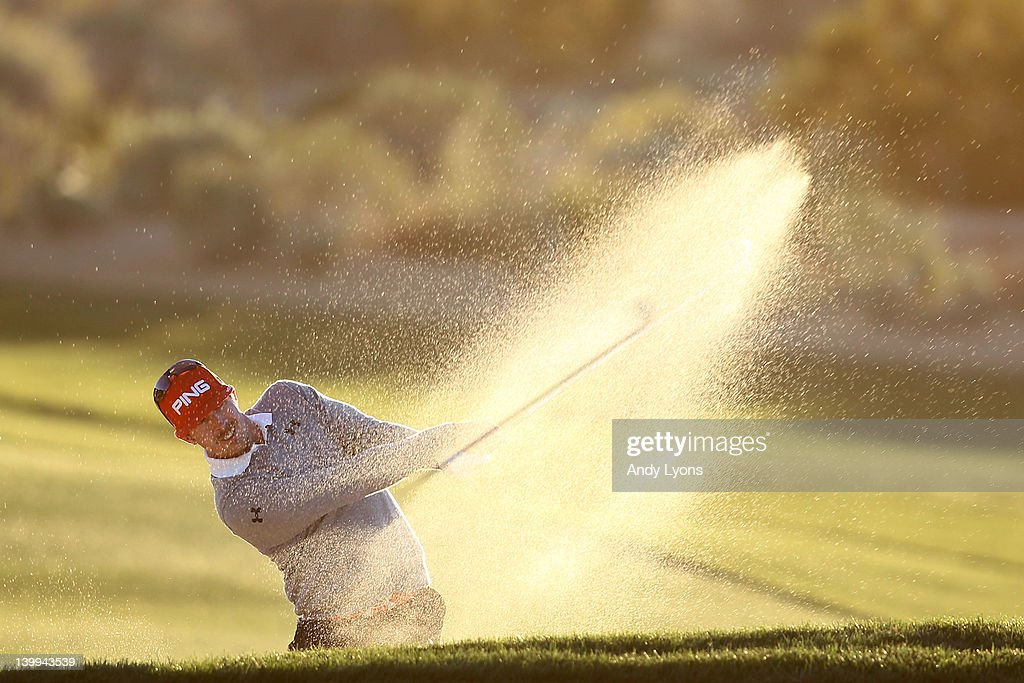 Hunter Mahan hits an approach shot from a bunker on the second hole during the semifinal round of the World Golf ChampionshipsAccenture Match Play...