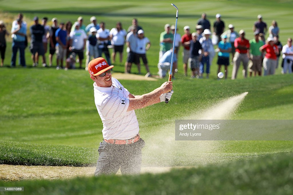 Hunter Mahan hits from a bunker on the 13th hole during the championship match of the final round of the World Golf ChampionshipsAccenture Match Play...