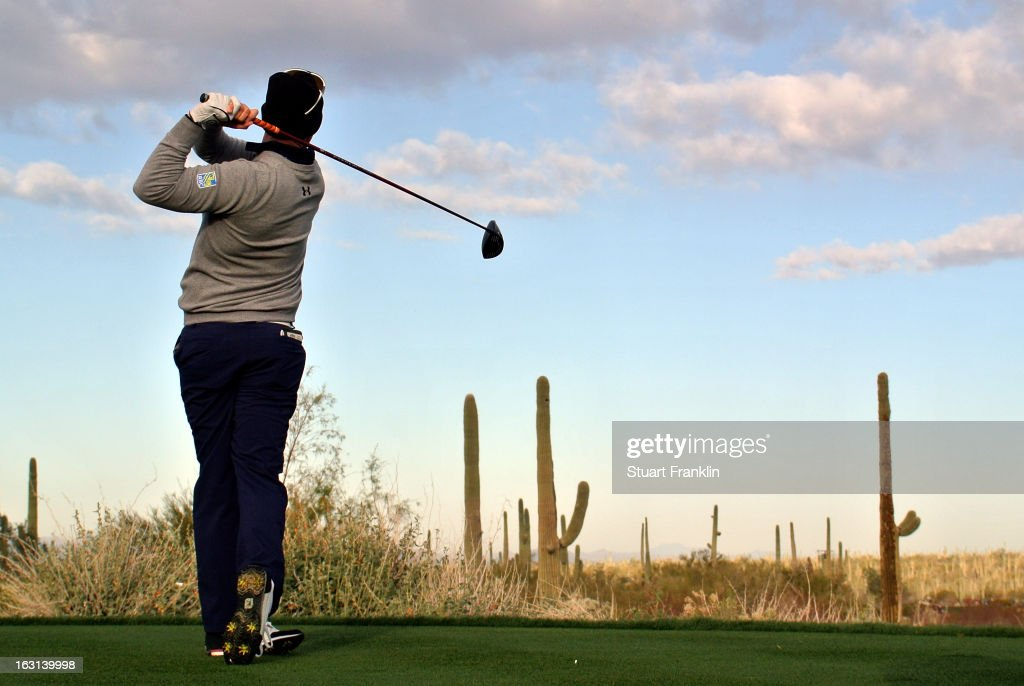 Hunter Mahan hits his tee shot during the semifinal round of the World Golf Championships - Accenture Match Play at the Golf Club at Dove Mountain on February 24, 2013 in Marana, Arizona.