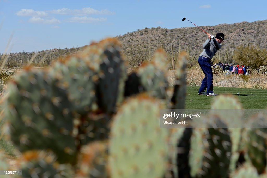 Hunter Mahan hits his tee shot on the ninth hole during the final round of the World Golf Championships - Accenture Match Play at the Golf Club at Dove Mountain on February 24, 2013 in Marana, Arizona.