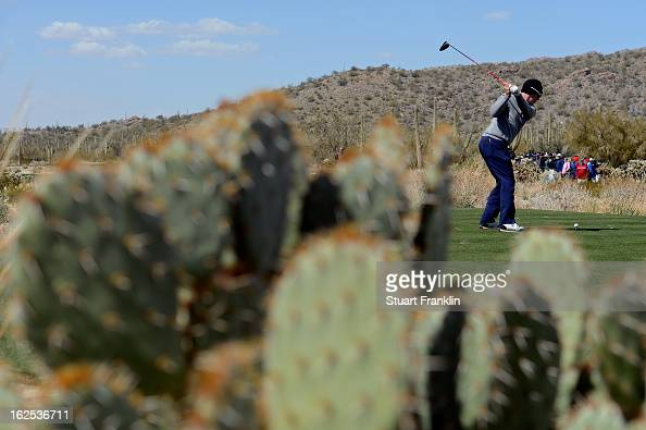 Hunter Mahan hits his tee shot on the ninth hole during the final round of the World Golf Championships Accenture Match Play at the Golf Club at Dove...
