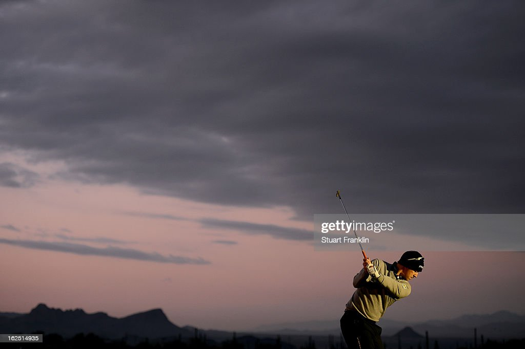 Hunter Mahan hits practice balls on the range prior to his semifinal round match of the World Golf Championships - Accenture Match Play at the Golf Club at Dove Mountain on February 24, 2013 in Marana, Arizona.