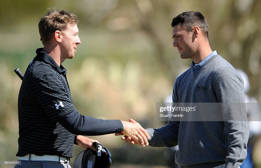 Hunter Mahan is congratulated by Martin Kaymer of Germany after Mahan won 5 and 4 during the third round of the World Golf Championships - Accenture Match Play at the Golf Club againstat Dove Mountain on February 23, 2013 in Marana, Arizona.