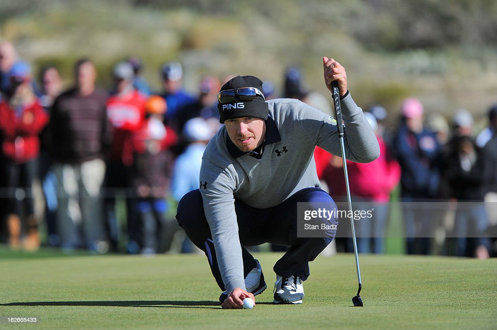 Hunter Mahan lines his ball on the 11th green during the final round of the World Golf Championships-Accenture Match Play Championship at The Golf Club at Dove Mountain on February 24, 2013 in Marana, Arizona.