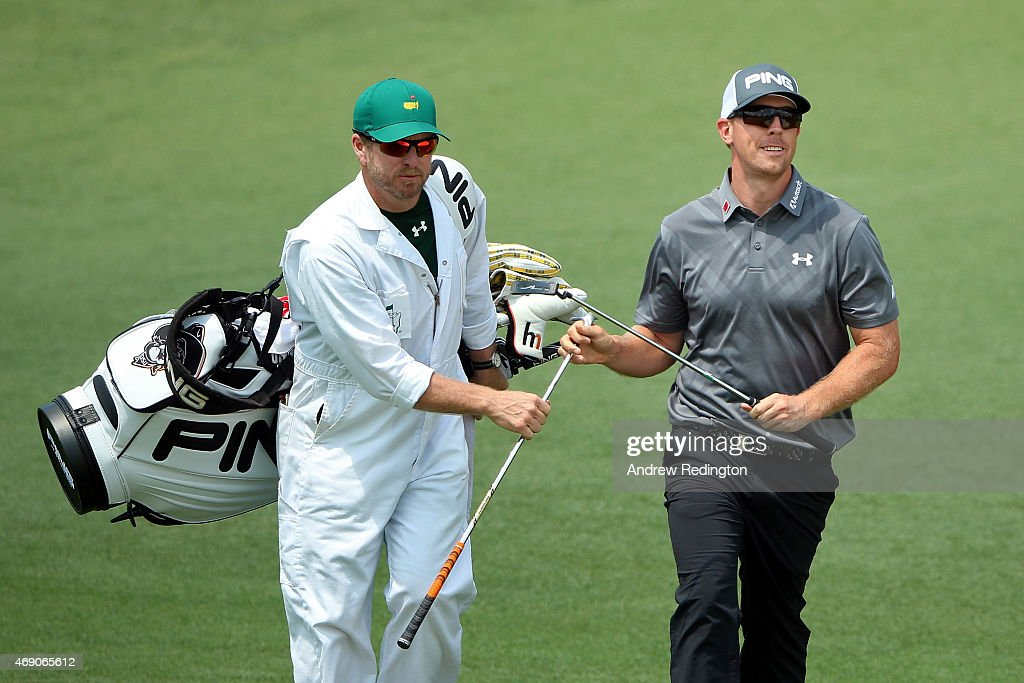 Hunter Mahan of the United States and his caddie John Wood during the first round of the 2015 Masters Tournament at Augusta National Golf Club on April 9, 2015 in Augusta, Georgia.