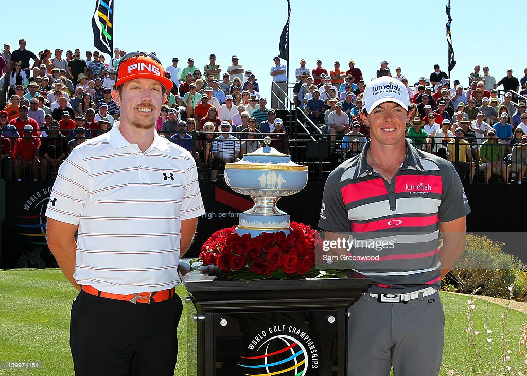 Hunter Mahan of the United States and Rory McIlroy of Northern Ireland smile alongside the Walter Hagen Cup on the first hole prior to starting the championship match of the final round of the World Golf Championships-Accenture Match Play Championship at the Ritz-Carlton Golf Club on February 26, 2012 in Marana, Arizona.