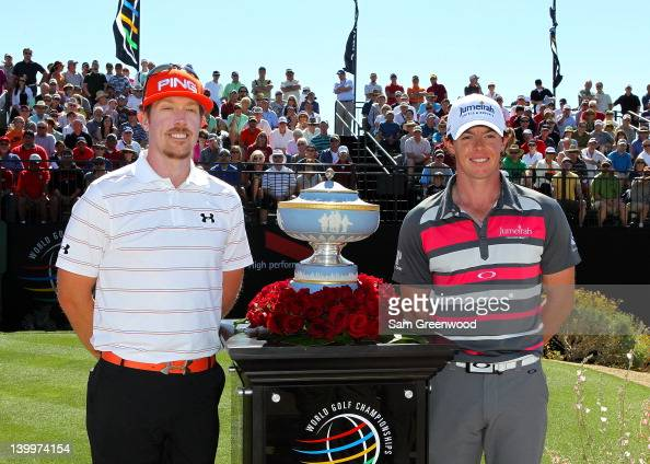 Hunter Mahan of the United States and Rory McIlroy of Northern Ireland smile alongside the Walter Hagen Cup on the first hole prior to starting the...