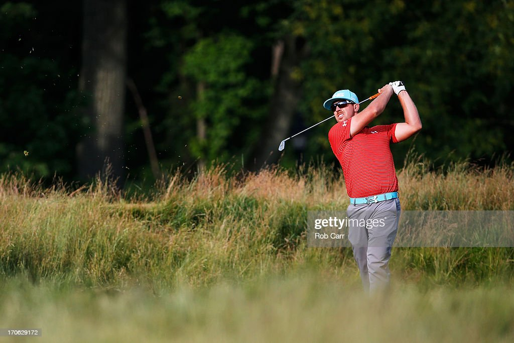 Hunter Mahan of the United States hits his second shot on the 14th hole during Round Three of the 113th US Open at Merion Golf Club on June 15 2013...