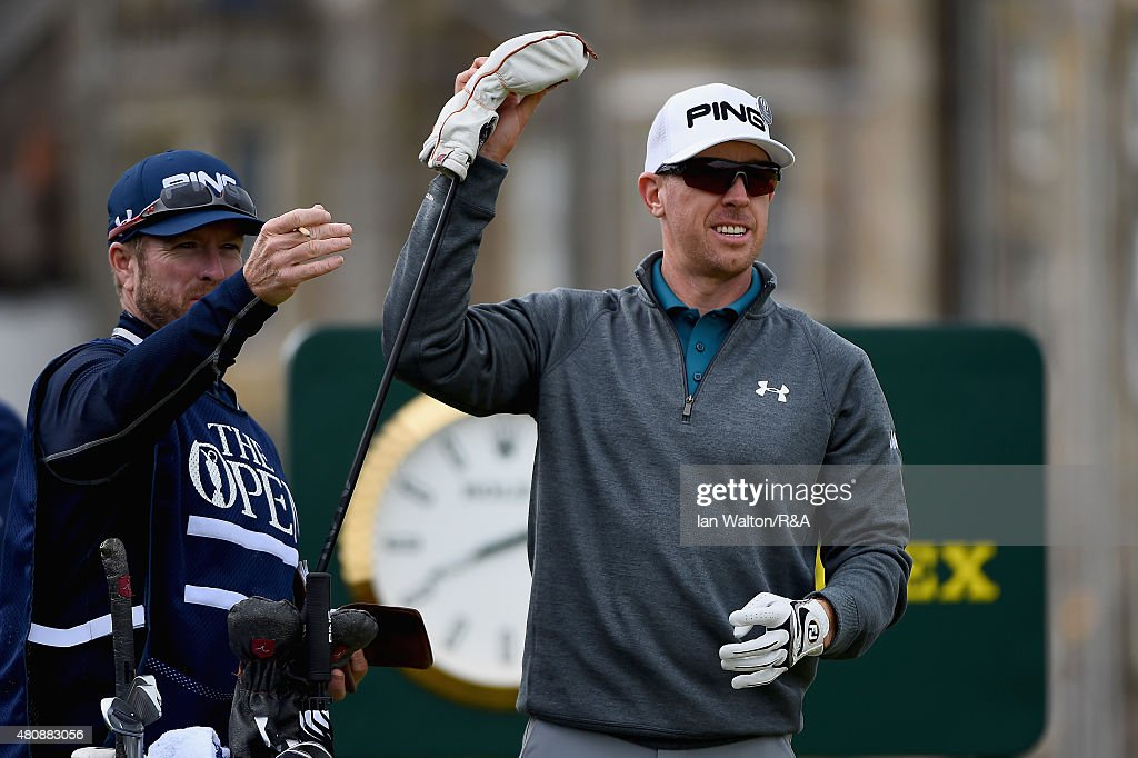 Hunter Mahan of the United States pulls a club from his bag alongside his caddie John Wood on the second tee during the first round of the 144th Open Championship at The Old Course on July 16, 2015 in St Andrews, Scotland.