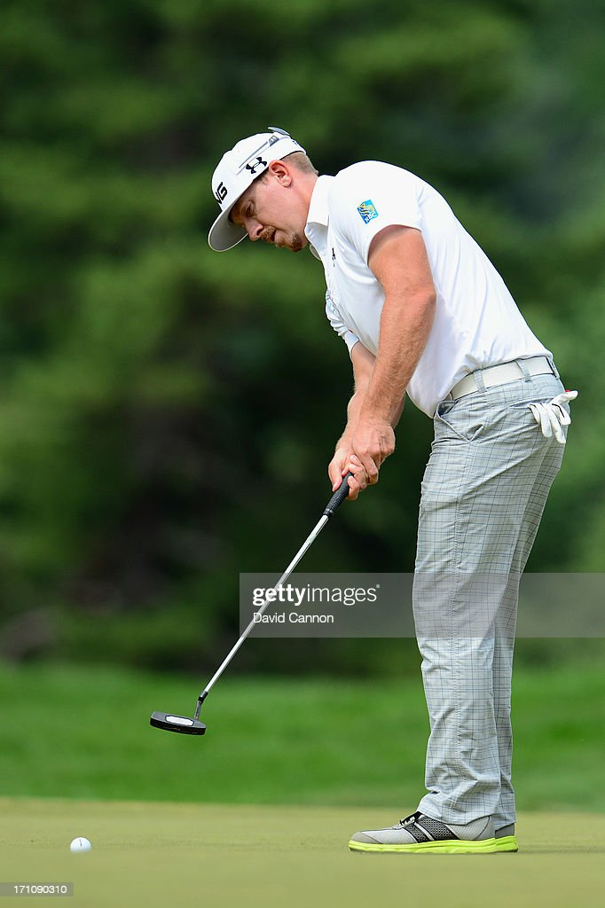 Hunter Mahan of the United States putts on the first green during the final round of the 113th U.S. Open at Merion Golf Club on June 16, 2013 in Ardmore, Pennsylvania.
