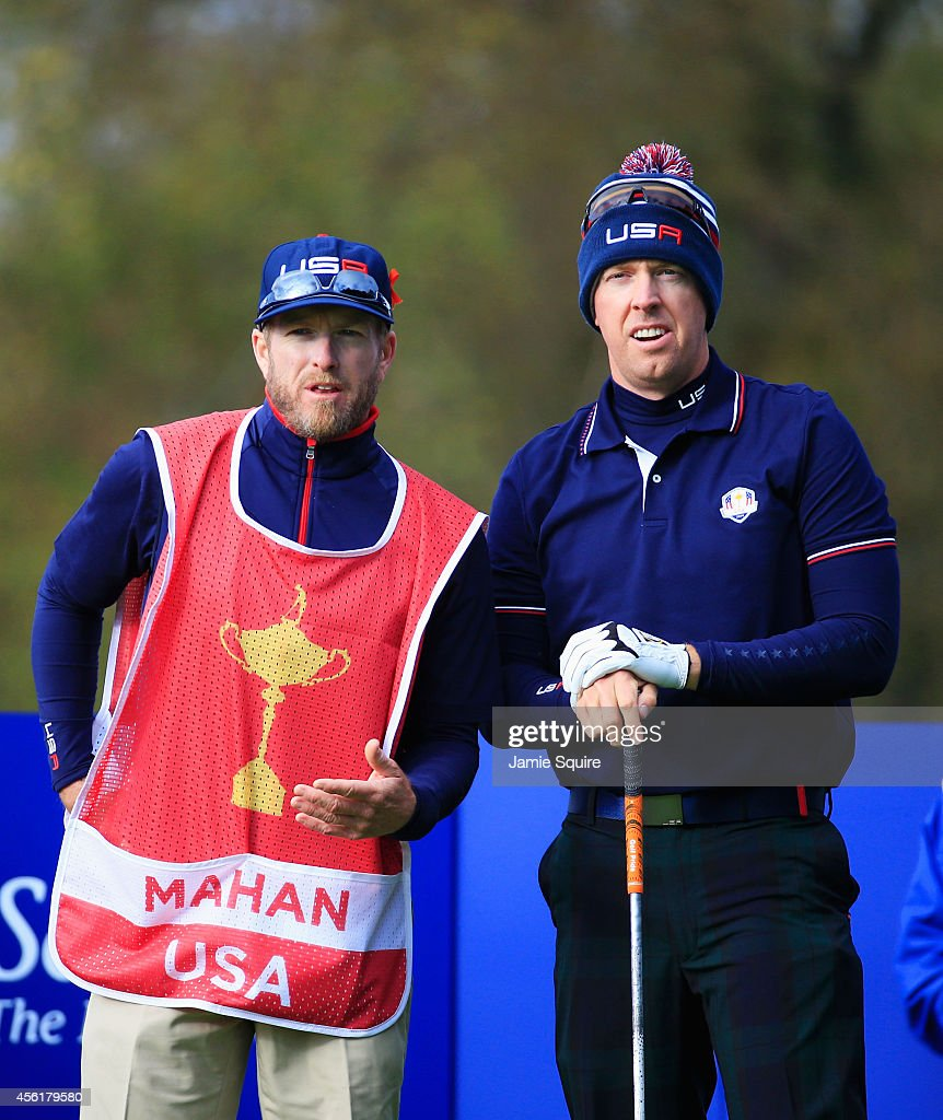 Hunter Mahan of the United States talks caddie John Wood on the seventh tee during the Morning Fourballs of the 2014 Ryder Cup on the PGA Centenary...