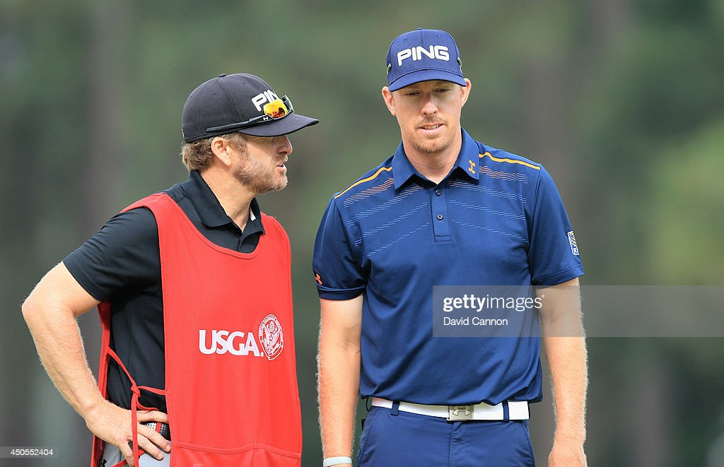 Hunter Mahan of the United States waits on the 12th green with his caddie John Wood during the second round of the 114th US Open at Pinehurst Resort...