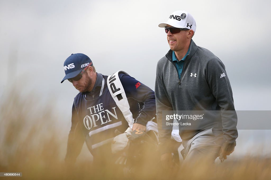 Hunter Mahan of the United States walks with caddie John Wood as he tees off on the 6th hole during the first round of the 144th Open Championship at The Old Course on July 16, 2015 in St Andrews, Scotland.