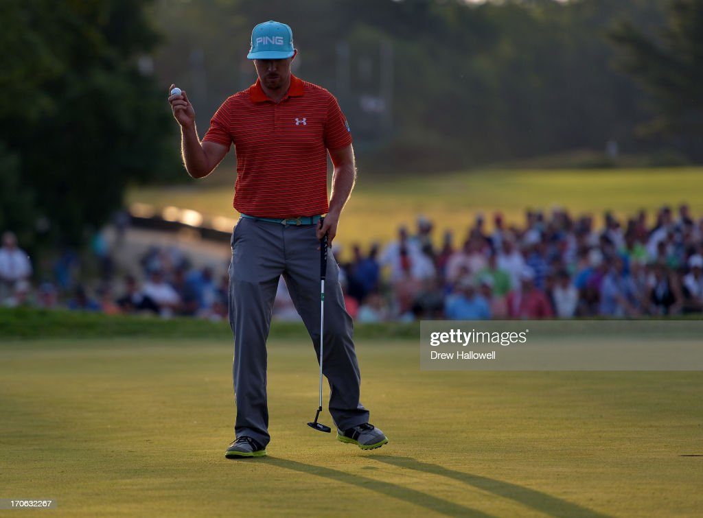 Hunter Mahan of the United States waves after putting on the 18th hole during Round Three of the 113th U.S. Open at Merion Golf Club on June 15, 2013 in Ardmore, Pennsylvania.