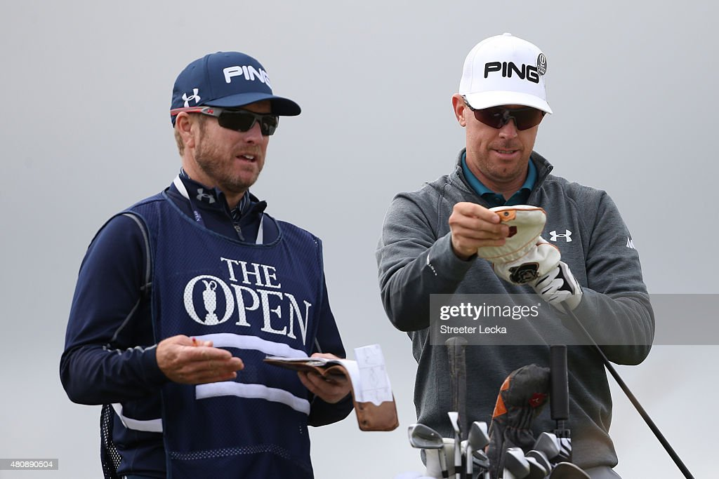 Hunter Mahan of the United States with caddie John Wood as he tees off on the 6th hole during the first round of the 144th Open Championship at The...