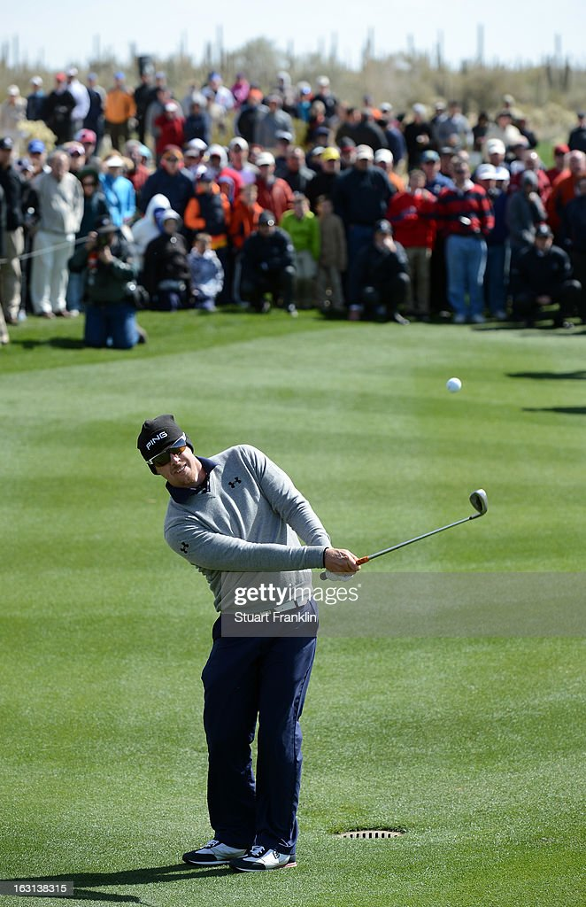 Hunter Mahan plays a shot as the gallery looks on during the final round of the World Golf Championships - Accenture Match Play at the Golf Club at Dove Mountain on February 24, 2013 in Marana, Arizona.