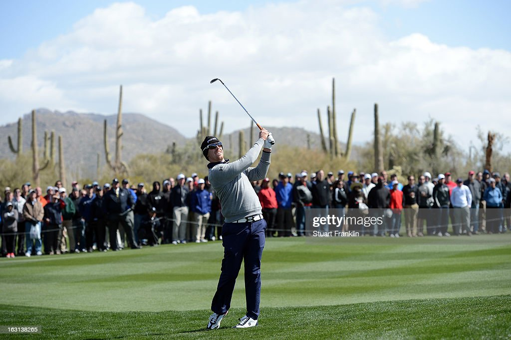 Hunter Mahan plays a shot during the final round of the World Golf Championships - Accenture Match Play at the Golf Club at Dove Mountain on February 24, 2013 in Marana, Arizona.