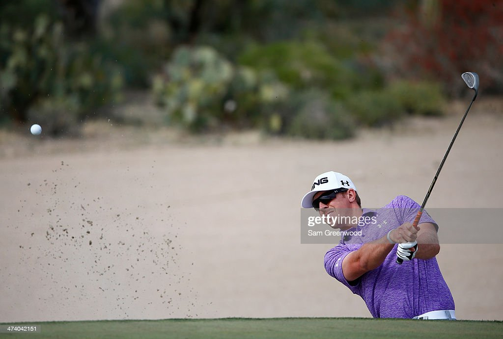 Hunter Mahan plays a shot on the 17th hole during the third round of the World Golf Championships - Accenture Match Play Championship at The Golf Club at Dove Mountain on February 21, 2014 in Marana, Arizona.