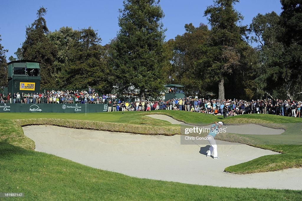 Hunter Mahan plays from a bunker on the 17th hole during the final round of the Northern Trust Open at Riviera Country Club on February 17, 2013 in Pacific Palisades, California.