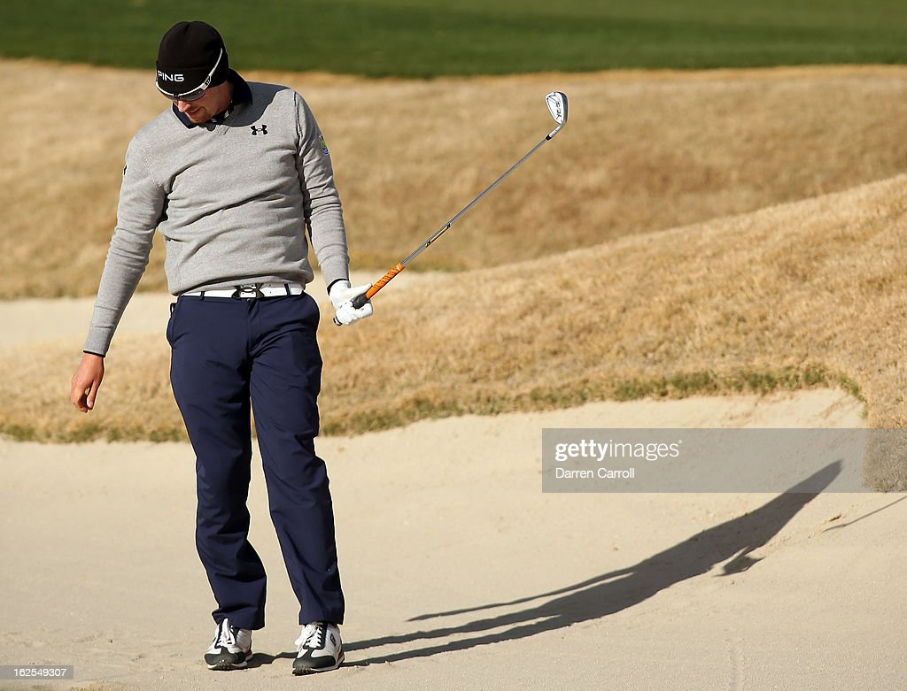 Hunter Mahan reacts after he hit a shot out of the bunker on the 17th hole during the final round of the World Golf Championships - Accenture Match Play at the Golf Club at Dove Mountain on February 24, 2013 in Marana, Arizona.