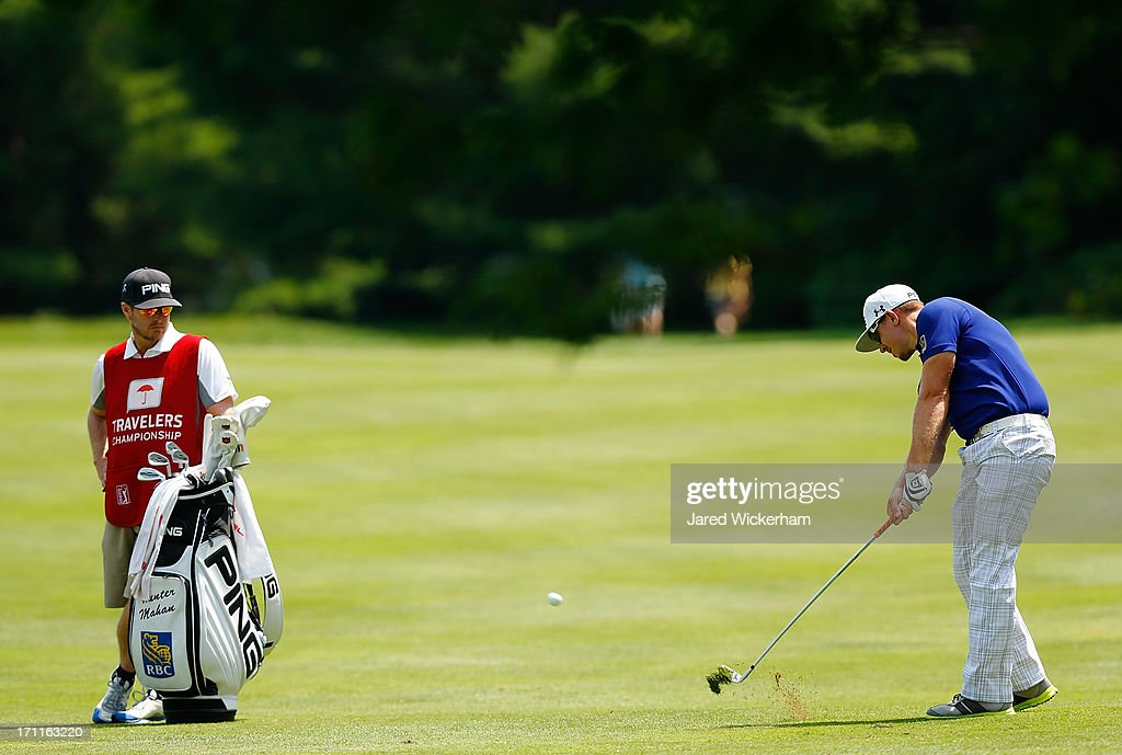 <a gi-track='captionPersonalityLinkClicked' href=/galleries/search?phrase=Hunter+Mahan&family=editorial&specificpeople=885292 ng-click='$event.stopPropagation()'>Hunter Mahan</a> takes his second shot on the 4th hole during the third round of the 2013 Travelers Championship at TPC River Highlands on June 22, 2012 in Cromwell, Connecticut.