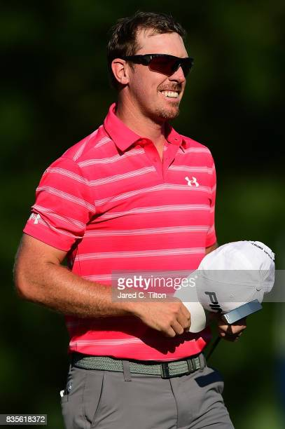 Hunter Mahan walks off the 18th green during the third round of the Wyndham Championship at Sedgefield Country Club on August 19 2017 in Greensboro...