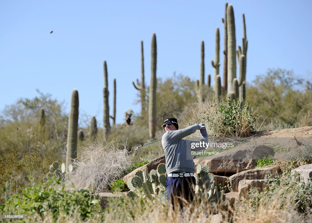 Hunter Mahan watches his shot during the final round of the World Golf Championships - Accenture Match Play at the Golf Club at Dove Mountain on February 24, 2013 in Marana, Arizona.