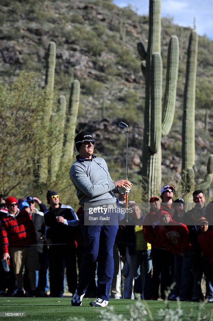 Hunter Mahan watches his tee shot on the 16th hole during the final round of the World Golf Championships-Accenture Match Play Championship at The Golf Club at Dove Mountain on February 24, 2013 in Marana, Arizona.