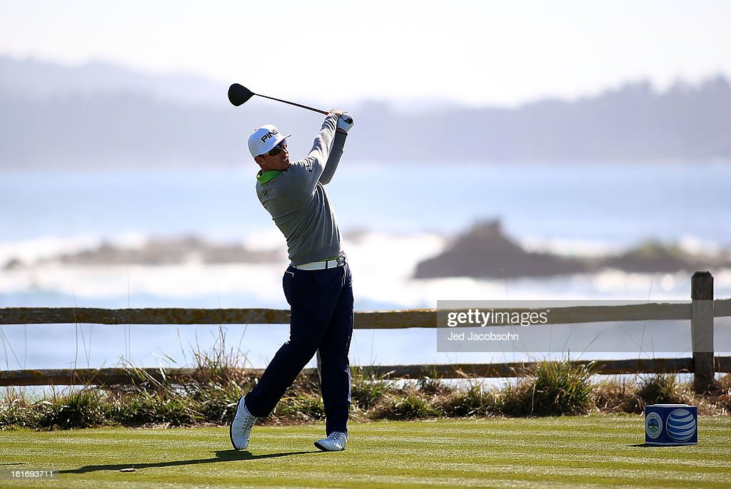 Hunter Mahan watches his tee shot on the 18th hole during the final round of the AT&T Pebble Beach National Pro-Am at Pebble Beach Golf Links on February 10, 2013 in Pebble Beach, California.