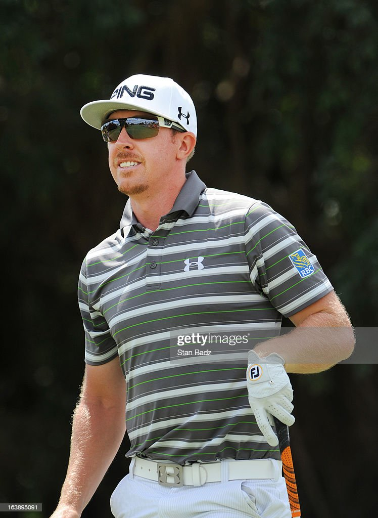Hunter Mahan watches his tee shot on the fifth hole during the final round of the World Golf Championships-Cadillac Championship at TPC Blue Monster at Doral on March 10, 2013 in Doral, Florida.