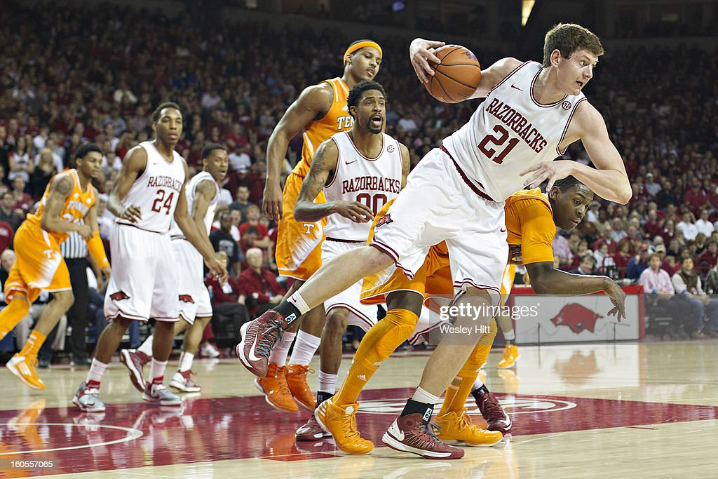 Hunter Mickelson #21 of the Arkansas Razorbacks fights for a rebound against the Tennessee Volunteers at Bud Walton Arena on February 2, 2013 in Fayetteville, Arkansas. The Razorbacks defeated the Volunteers 73-60.