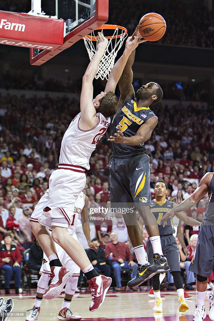 Hunter Mickelson #21 of the Arkansas Razorbacks has his shot blocked by Keion Bell #5 of the Missouri Tigers at Bud Walton Arena on February 16, 2013 in Fayetteville, Arkansas. The Razorbacks defeated the Tigers 73-71.