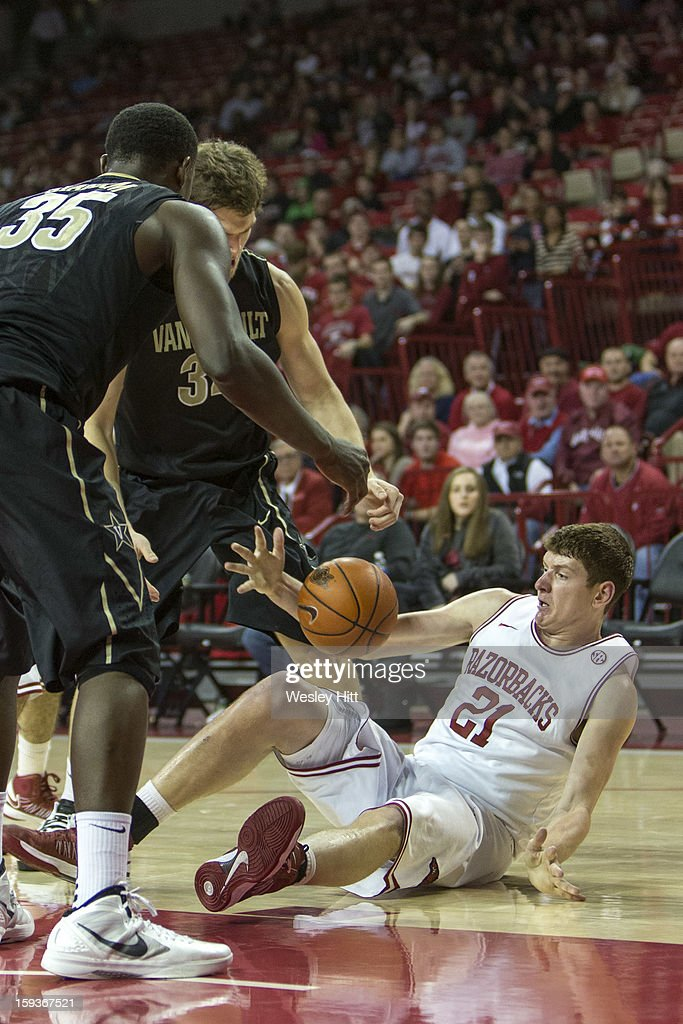 Hunter Mickelson #21 of the Arkansas Razorbacks tries to save the ball after going up for a rebound against the Vanderbilt Commodores at Bud Walton Arena on January12, 2013 in Fayetteville, Arkansas. The Razorbacks defeated the Commodores 56-33.